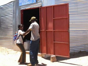 Relationship Wrestle Outside a Township Shebeen