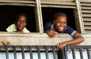 Faces At the Window in Beira