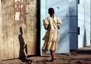 Tanzanian Girl By The Door