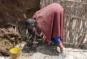 Masai Woman Building Her House
