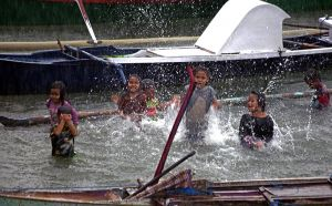 Kids in the Rain in Labuan Bajo Harbour