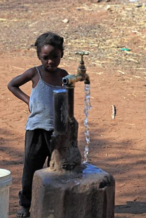 Small Leya Girl at Water Tap Zambia
