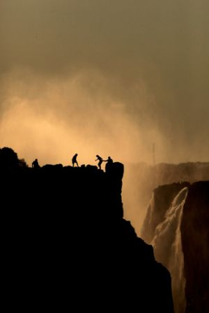 Victoria Falls Looking at Figures in Zimbabwee