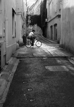 Early morning cyclist in Arles, Southern France.