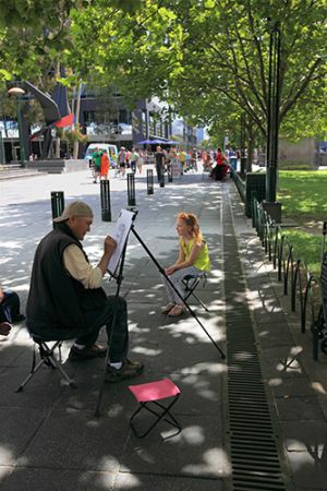 Street Artist Painting Portraits Beside The Yarra