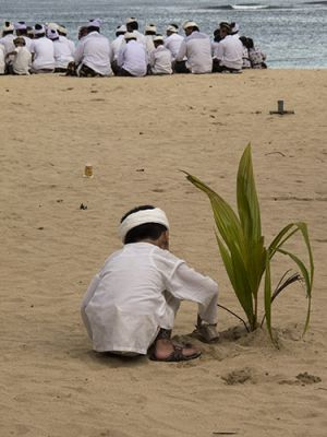 Boy Playing in the Sand at Melati Ceremony