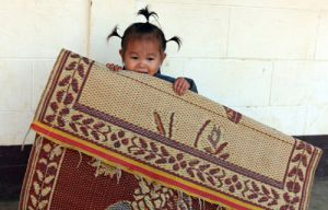 Rug Rat - Lao Child  in a Small Village