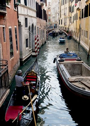 Gondolier on the Canals Venice